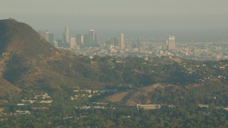 HDA06_02 - 1080 stock footage aerial video Downtown Los Angeles skyline, seen from the Hollywood Hills in California at sunset