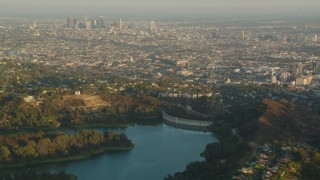 HDA06_07 - 1080 stock footage aerial video Downtown Los Angeles skyline at sunset seen from the Mulholland Dam in the Hollywood Hills, California