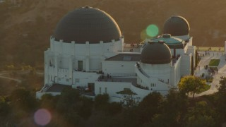 HDA06_11 - 1080 stock footage aerial video orbit of the Griffith Observatory at sunset in California