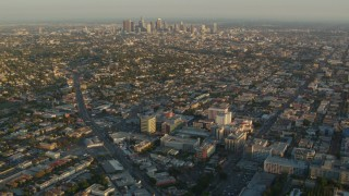 HDA06_12 - 1080 stock footage aerial video approach Children's Hospital Los Angeles and Downtown Los Angeles at sunset, California