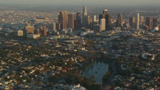 HDA06_16 - 1080 stock footage aerial video Downtown Los Angeles seen from Echo Lake at sunset, Echo Park, California