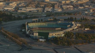 HDA06_17 - 1080 stock footage aerial video approaching the Dodger Stadium baseball stadium at sunset, Los Angeles, California