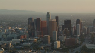HDA06_19 - 1080 stock footage aerial video Downtown Los Angeles skyscrapers at sunset in California