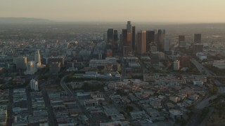 HDA06_20 - 1080 stock footage aerial video Los Angeles City Hall and skyscrapers at sunset in Downtown Los Angeles, California