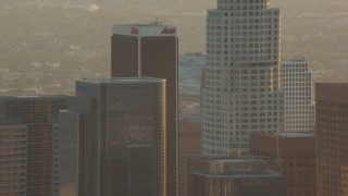 HDA06_21 - 1080 stock footage aerial video tops of skyscrapers at sunset in Downtown Los Angeles, California