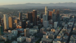 HDA06_25 - 1080 stock footage aerial video flyby high-rises and skyscrapers at sunset in Downtown Los Angeles, California
