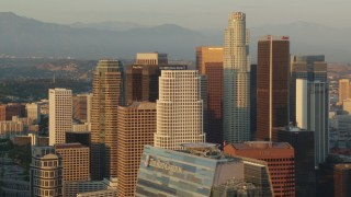 HDA06_27 - 1080 stock footage aerial video flying by the skyscrapers of Downtown Los Angeles at sunset, California