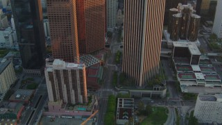 HDA06_31 - 1080 stock footage aerial video tilt and follow S Hope Street at sunset in Downtown Los Angeles, California