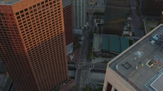 HDA06_32 - 1080 stock footage aerial video bird's eye view of S Hope Street through Downtown Los Angeles at sunset, California