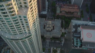 HDA06_33 - 1080 stock footage aerial video bird's eye view of S Hope Street and the Los Angeles Public Library at sunset, Downtown Los Angeles, California