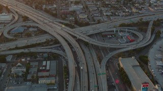 HDA06_36 - 1080 stock footage aerial video the interchange of 110 and 10 with light traffic at sunset in Downtown Los Angeles, California