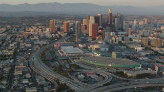 HDA06_37 - 1080 stock footage aerial video the 110 and 10 freeway interchange, LA Convention Center, and Downtown Los Angeles, California at sunset