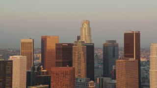 HDA06_39 - 1080 stock footage aerial video group of Downtown Los Angeles skyscrapers at sunset, California