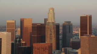 HDA06_40 - 1080 stock footage aerial video approach skyscrapers at sunset in Downtown Los Angeles while zooming out, California