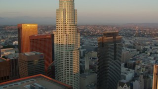 HDA06_42 - 1080 stock footage aerial video approach US Bank Tower and Gas Company Tower at sunset in Downtown Los Angeles, California