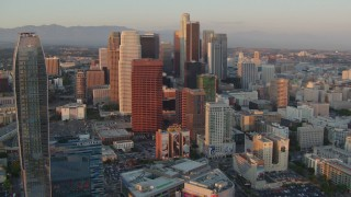 HDA06_46 - 1080 stock footage aerial video flyby skyscrapers at sunset in Downtown Los Angeles, California to reveal The Ritz-Carlton