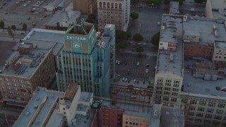 HDA06_48 - 1080 stock footage aerial video orbit Eastern Columbia Building condo complex at sunset in Downtown Los Angeles, California