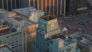 HDA06_49 - 1080 stock footage aerial video orbit the Eastern Columbia Building to reveal the Orpheum Theater at sunset, Downtown Los Angeles, California