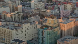 HDA06_50 - 1080 stock footage aerial video of the Eastern Columbia Building and Orpheum Theater at sunset, Downtown Los Angeles, California