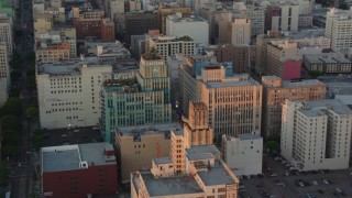 HDA06_51 - 1080 stock footage aerial video flyby Eastern Columbia Building and Orpheum Theater to reveal Broadway at sunset, Downtown Los Angeles, California