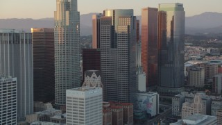 HDA06_52 - 1080 stock footage aerial video tilt from Eastern Columbia Building to reveal and approach skyscrapers in Downtown Los Angeles, California at sunset