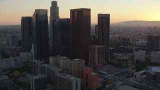 HDA06_56 - 1080 stock footage aerial video approach the Downtown Los Angeles skyline at sunset, California