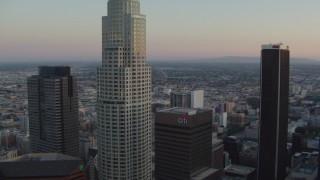 HDA06_57 - 1080 stock footage aerial video flyby top of Bank of America Center, focus on US Bank Tower at twilight, Downtown Los Angeles, California