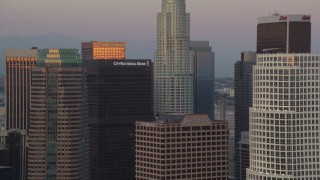 HDA06_59 - 1080 stock footage aerial video skyscrapers near US Bank Tower at twilight in Downtown Los Angeles, California