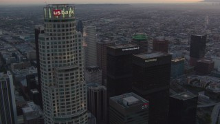 HDA06_62 - 1080 stock footage aerial video orbit top of US Bank Tower to reveal other skyscrapers in Downtown Los Angeles, California at twilight