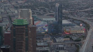 HDA06_63 - 1080 stock footage aerial video flyby skyscrapers in Downtown Los Angeles at twilight to reveal Staples Center and Ritz-Carlton in California