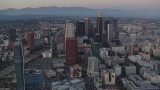 HDA06_66 - 1080 stock footage aerial video tilt from Staples Center and Nokia Theater to reveal Downtown Los Angeles, California, twilight