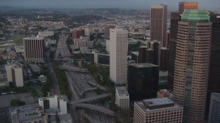 HDA06_68 - 1080 stock footage aerial video tilt to light traffic on the 110 freeway by skyscrapers in Downtown Los Angeles, California, twilight