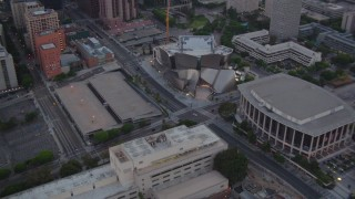 HDA06_70 - 1080 stock footage aerial video orbit Walt Disney Concert Hall and Dorothy Chandler Pavilion at twilight in Downtown Los Angeles, California