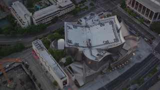 HDA06_71 - 1080 stock footage aerial video an orbit of the Walt Disney Concert Hall at twilight in Downtown Los Angeles, California