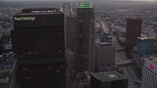 HDA06_76 - 1080 stock footage aerial video flyby Downtown Los Angeles skyscrapers at twilight to reveal Staples Center and Ritz-Carlton in California