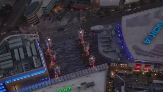 HDA06_78 - 1080 stock footage aerial video tilt to bird's eye view of Nokia Theater and Staples Center at twilight, Downtown Los Angeles, California