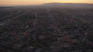 HDA06_79 - 1080 stock footage aerial video Los Angeles urban neighborhoods at twilight, California