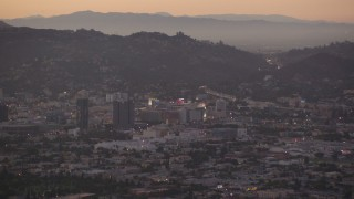 HDA06_80 - 1080 stock footage aerial video approach office buildings and Capitol Records at twilight in Hollywood, California