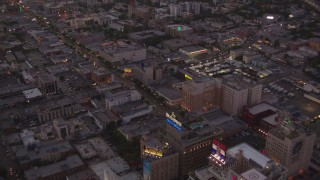 HDA06_82 - 1080 stock footage aerial video fly over office buildings and W Hotel near Capitol Records to follow Hollywood Boulevard at twilight, Hollywood, California