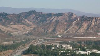 HDA07_05 - 1080 stock footage aerial video of the Los Angeles Aqueduct and mountains in San Fernando Valley, California
