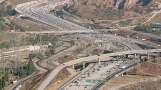 HDA07_07 - 1080 stock footage aerial video following I-5 with heavy traffic, San Fernando Valley, California