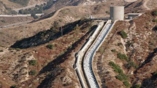 HDA07_09 - 1080 stock footage aerial video of approaching the top of the Los Angeles Aqueduct; San Fernando Valley, California