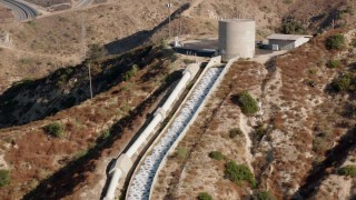 HDA07_10 - 1080 stock footage aerial video of the top of the Los Angeles Aqueduct, San Fernando Valley, California