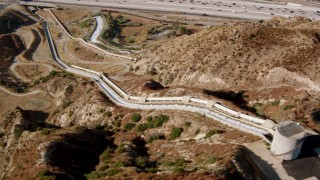HDA07_11 - 1080 stock footage aerial video flying over the Los Angeles Aqueduct to reveal I-5, San Fernando Valley, California
