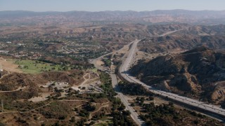 HDA07_15 - 1080 stock footage aerial video of following Highway 14 in Newhall, California