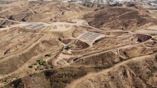 HDA07_18 - 1080 stock footage aerial video fly over hills to new home construction, Santa Clarita Valley, California