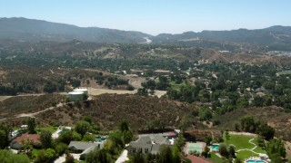 HDA07_24 - 1080 stock footage aerial video of flying over hills and homes in Newhall, California