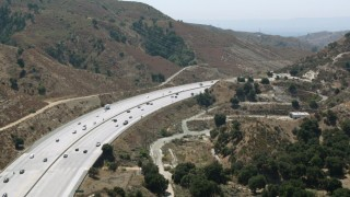HDA07_28 - 1080 aerial stock footage video of Newhall Pass with light traffic in Santa Clarita, California