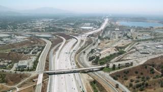 HDA07_32 - 1080 stock footage aerial video of following 5 freeway to reservoir in Granada Hills, California