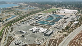 HDA07_33 - 1080 aerial stock footage video of a water treatment plant in Granada Hills, California
